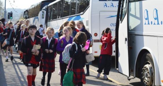 children getting school bus
